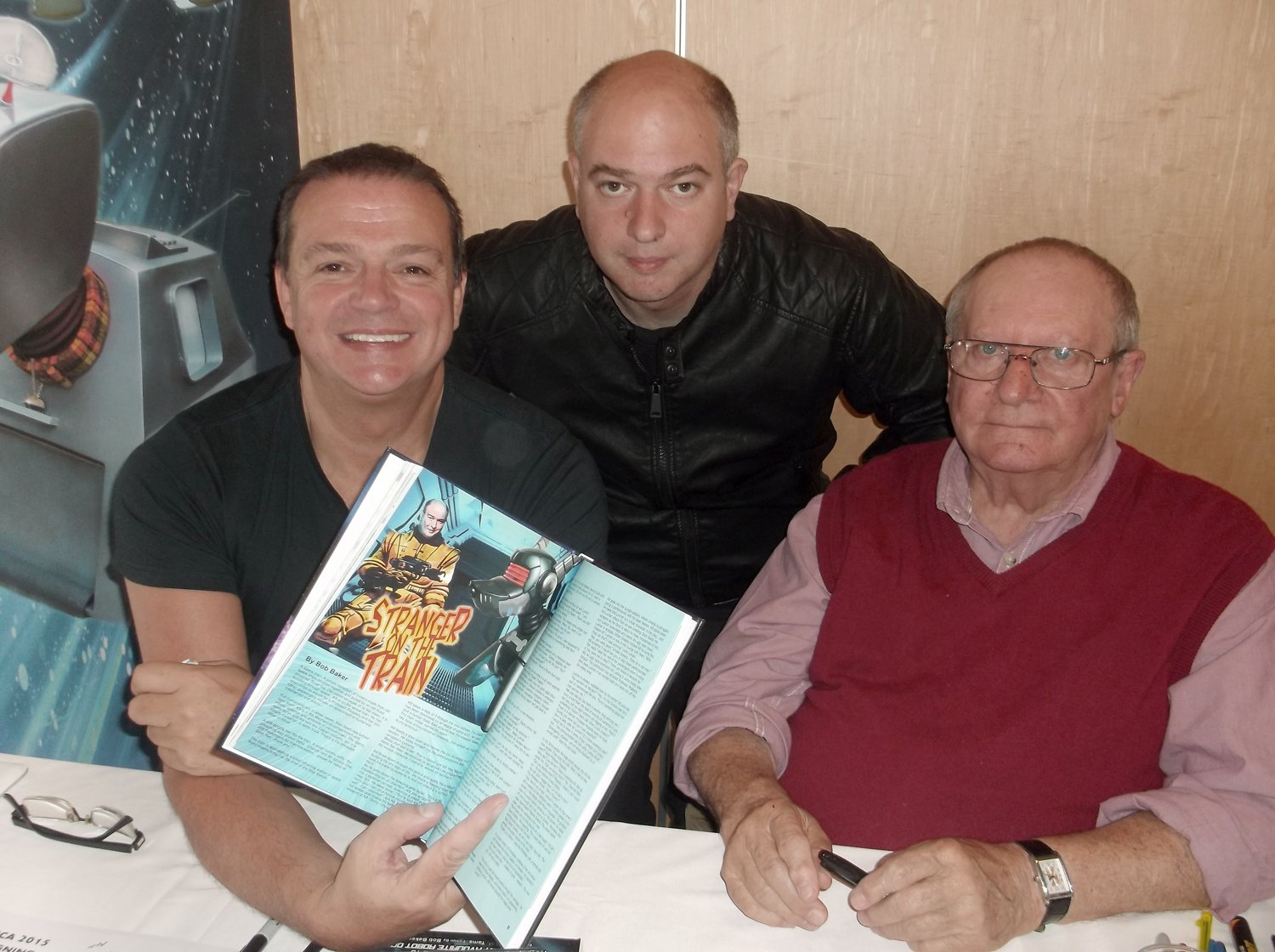 Andrew O'Day with Paul Tams and Bob Baker and a copy of The Essential Book of K9 which stars Andrew on page 86